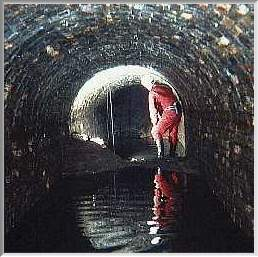 Club member inside tunnel - under 'well' shaft